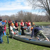 Always hold on to the gunnels while moving in the canoe, and keep your weight low!