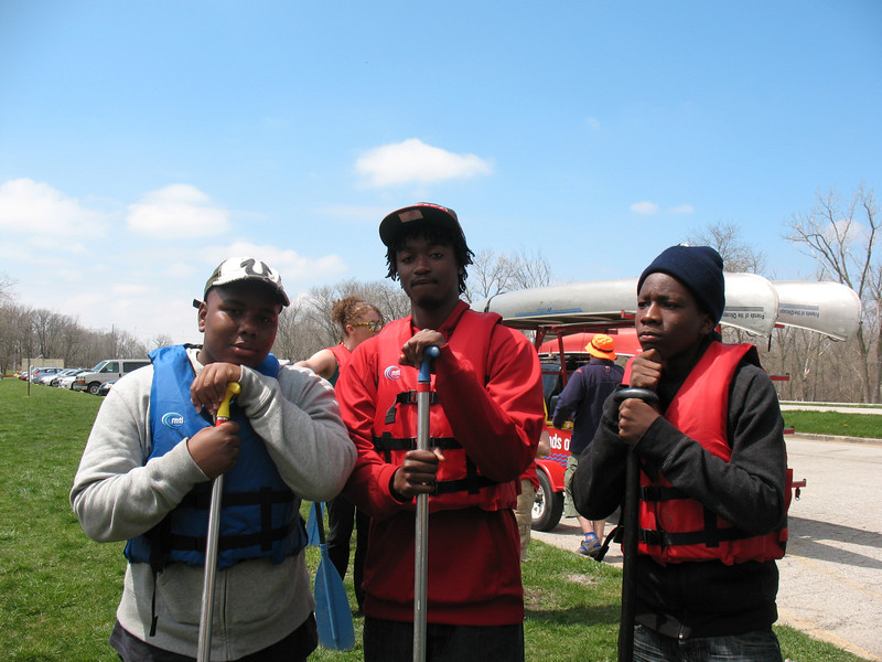 First things first: we get our life jackets on and select a paddle. These guys from Youth Corps are definitely ready for some adventure.